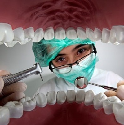 A view looking out from a mouth to a dentist doing an exam.